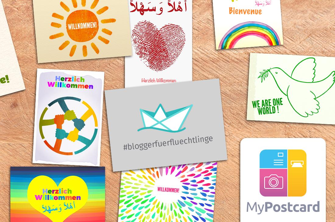 """Flatlay mit Postkartenmotiven von """"Blogger für Flüchtlinge"""""""
