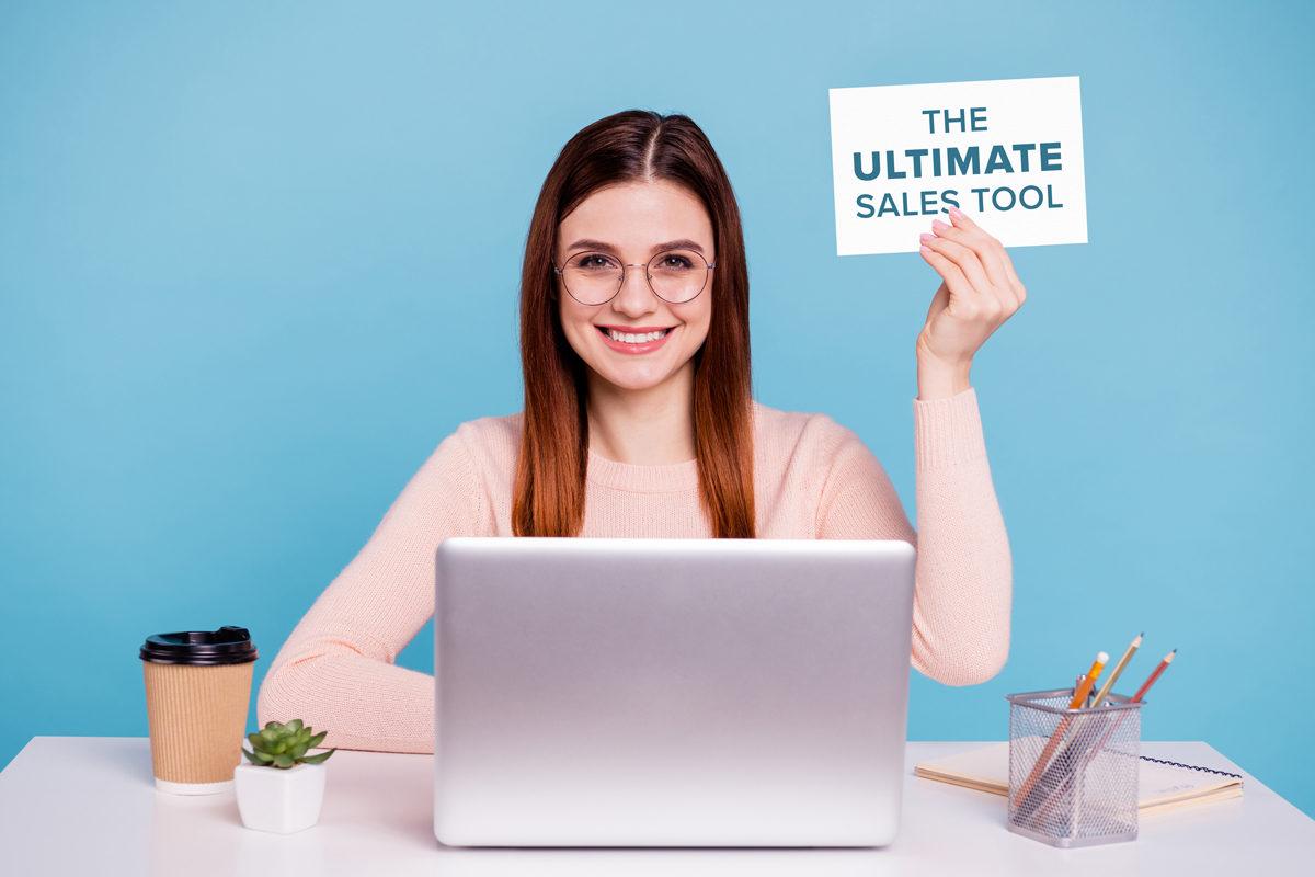 woman, postcard, laptop